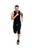 Full length portrait of a fitness man running Stock Image