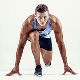 Full length portrait of a fitness man running isolated on a white background.  stock photography