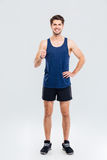 Full length portrait of a fitness man showing thumb up Royalty Free Stock Photos
