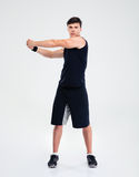 Full length portrait of a fitness man stretching hands Royalty Free Stock Photo