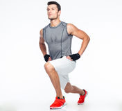 Full length portrait of a fitness man stretching Royalty Free Stock Images