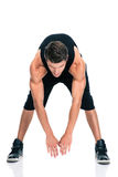 Full length portrait of a fitness man stretching Stock Photography