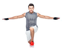 Full length portrait of a fitness man stretching Stock Photos