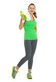 Full length portrait of fitness woman with bottle of water Royalty Free Stock Photo