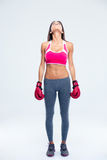 Full length portrait of a fitness woman in boxing gloves Stock Photo