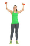 Full length portrait of fitness woman with dumbbells rejoicing Royalty Free Stock Images