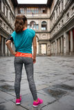 Full length portrait of fitness woman standing in front of uffiz Stock Photography