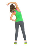 Full length portrait of fitness woman stretching . rear view Royalty Free Stock Photography