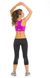 Full length portrait of fitness young woman. rear view Stock Images