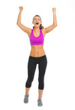 Portrait of fitness young woman rejoicing success Royalty Free Stock Image