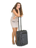 Frustrated young woman with wheel bag Royalty Free Stock Photography
