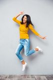Full length portrait of a funny woman jumping Stock Photography