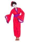 Full length portrait of geisha inviting. Isolated on white Stock Photos