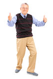Full length portrait of a gentleman giving thumbs up Stock Photo