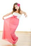 Full length portrait of girl in elegant dress with rose Stock Photography