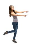 Full-length portrait of girl pointing hand gesturing Stock Photography