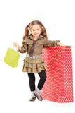 Full length portrait of a girl posing next to a shopping bag Royalty Free Stock Images