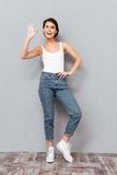 Full length portrait of a girl showing ok sign Stock Images