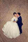 Full-length portrait of a gorgeous couple of bride and groom. The view from above. Full length photo Royalty Free Stock Image