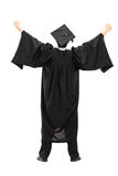 Full length portrait of graduate student with raised hands, rear. Full length portrait of graduate student with raised hands isolated on white background, rear Stock Images