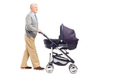 Full length portrait of a grandfather pushing his baby nephew in Stock Images