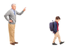 Full length portrait of a grandfather reprimanding a little boy. Isolated on white background stock image