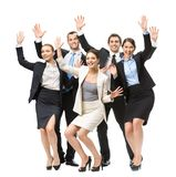 Full-length portrait of group of happy executives. With hands up, isolated on white. Concept of teamwork and cooperation royalty free stock photography