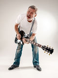 Full length portrait of a guitar player Royalty Free Stock Photography