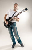 Full length portrait of a guitar player Stock Image
