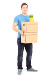 Full length portrait of a guy carrying removal boxes Royalty Free Stock Images