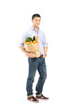 Full length portrait of a guy holding a shopping bag Royalty Free Stock Photography