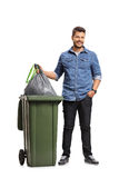 Full length portrait of a guy taking out the garbage Stock Images