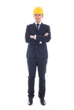 Full length portrait of handsome business man in yellow builder' Royalty Free Stock Image