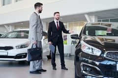 Car Salesman Helping Client stock photography