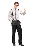 Full length portrait of a handsome man giving a thumb up Royalty Free Stock Images