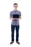 Full length portrait of handsome teenage boy holding laptop with. Blank screen isolated on white background Stock Photography