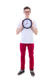 Full length portrait of handsome teenage boy holding office cloc Stock Photography