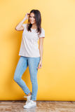 Full length portrait of a happy attractive woman Stock Photography