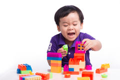 kid playing with block toys, asian small boy playing indoor games, colorful plastic block toys, making toy house, over white royalty free stock photos