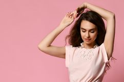 Full length portrait of happy beautiful woman in pink blouse posing in studio  on white background