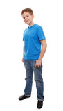 Teenage boy. Full length portrait of a happy boy standing isolated over white background stock photos
