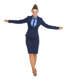 Full length portrait of happy business woman balancing. High-resolution photo royalty free stock photography