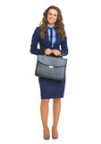 Full length portrait of happy business woman with briefcase Royalty Free Stock Image