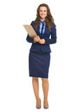 Full length portrait of happy business woman with clipboard. Isolated on white stock photos