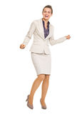 Full length portrait of happy business woman dancing Stock Photo