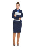 Full length portrait of happy business woman with folder Royalty Free Stock Photo