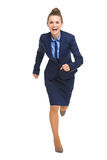 Full length portrait of happy business woman running straight Stock Images