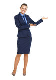 Full length portrait of happy business woman showing something Royalty Free Stock Image