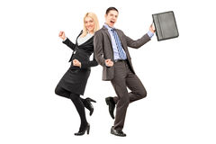 Full length portrait of a happy businesspeople celebrating succe. Ss  on white background Stock Image