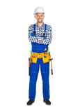Full length portrait of happy construction worker in uniform and. Tool belt isolated on white background. Crossed arms Stock Photography